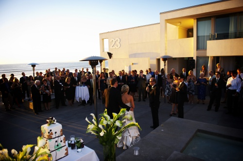 There's nothing like a wedding toast at sunset on the beach. . .