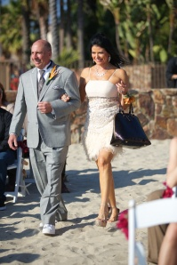 Stunning Italian mother of the groom, rocking her stiletto heels in the sand - how does she do that!?