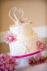 SweetCheeks bakery's sophisticated wedding cake adorned with starfish
