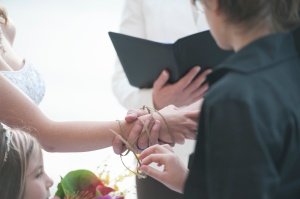"The ""HandBinding"" ritual includes six questions of vows and commitment. / Photo by Hung C. Tran Photography"
