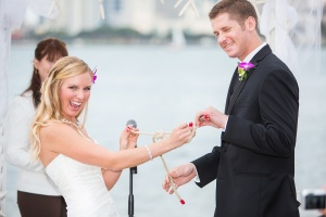 "Jen and Jon loved sailing, so ""tying the knot"" as their unity ceremony made perfect sense. Photo by Philip DeFalco"