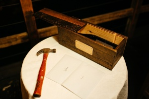 Just enough room for a bottle of wine, opener, two letters. And I love the well-used old hammer - what a great touch! Photo by Anika London.