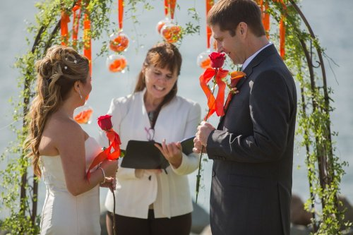 DO: Beautiful vibrant colors add whimsy and fun to this wedding ceremony. DON'T: It was a windy day, and the ribbons kept wrapping around me and going in my face, the baubles flapping in the breeze