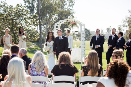 DO: Chandelier crystals sparkle in the sunlight and add a touch of elegance outdoors, at Lomas Santa Fe Country Club DON'T: As officiant it was challenging to stand under the arch in a way that it didn't look like there is a chandelier on my head. Photo by Cavin Elizabeth Photography