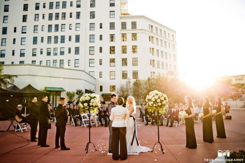 A simple arrangement of two pedestals of vibrant florals sets the space in an elegant way, on the terrace of El Cortez, downtown San Diego. Photo by True Photography