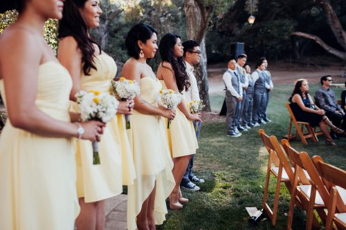 Wedding attendants create a beautiful human backdrop outside the circle. Photo by Melissa Abiador