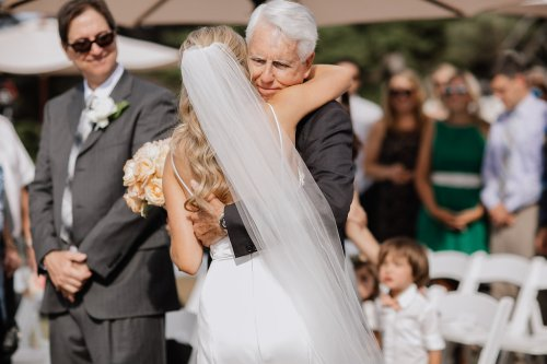 dad-bride hug