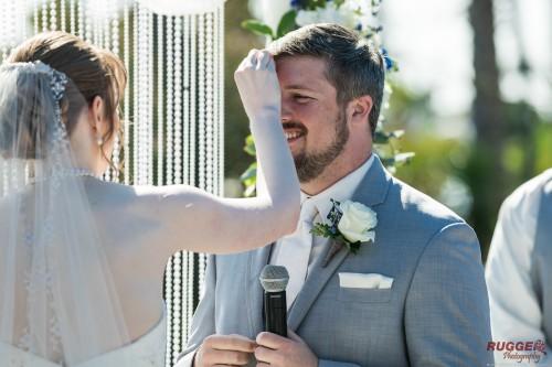 bride wiping groom brow